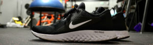 Black sneaker on ground in physiotherapist gym Martensville