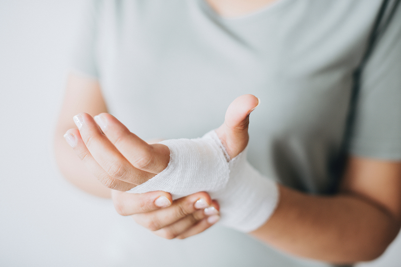 Person with bandage on wrist and hand