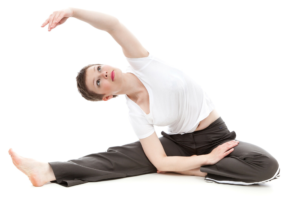 Person sitting on floor stretching